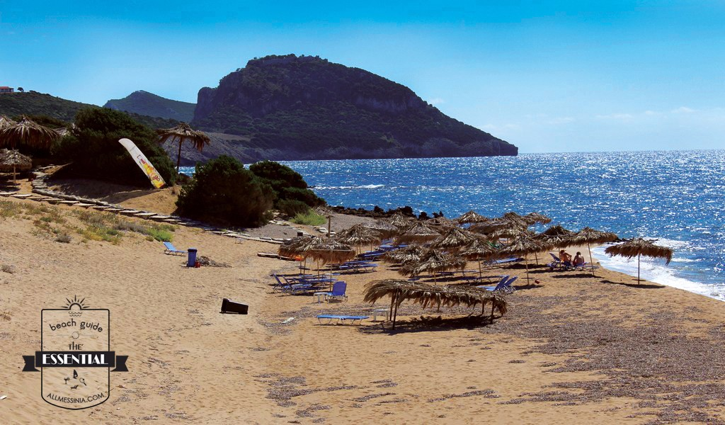 Petrohori Beach - Sundbeds, umbrellas and mountain view