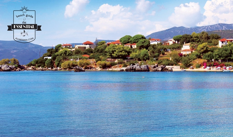 Stoupa Beach -  Crystal clear blue water and houses on the cliff