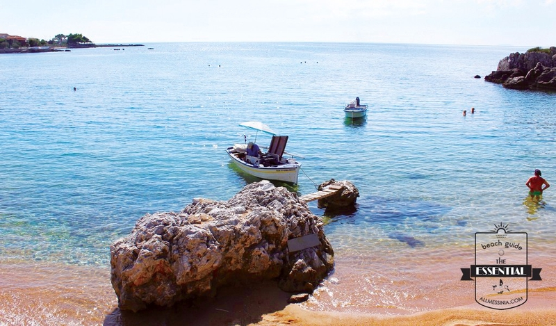 Stoupa Beach - Calm water with fishery boats